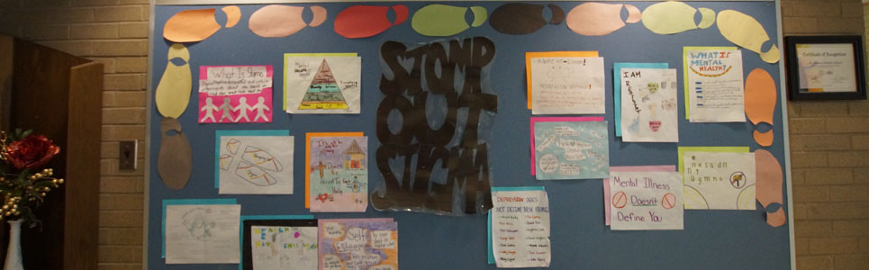 "Mental Health bulletin board with the saying, ""Stomp Out Stigma""."
