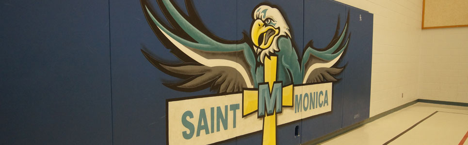 St. Monica Catholic School mascot and logo painted on gym mats in the school gym.